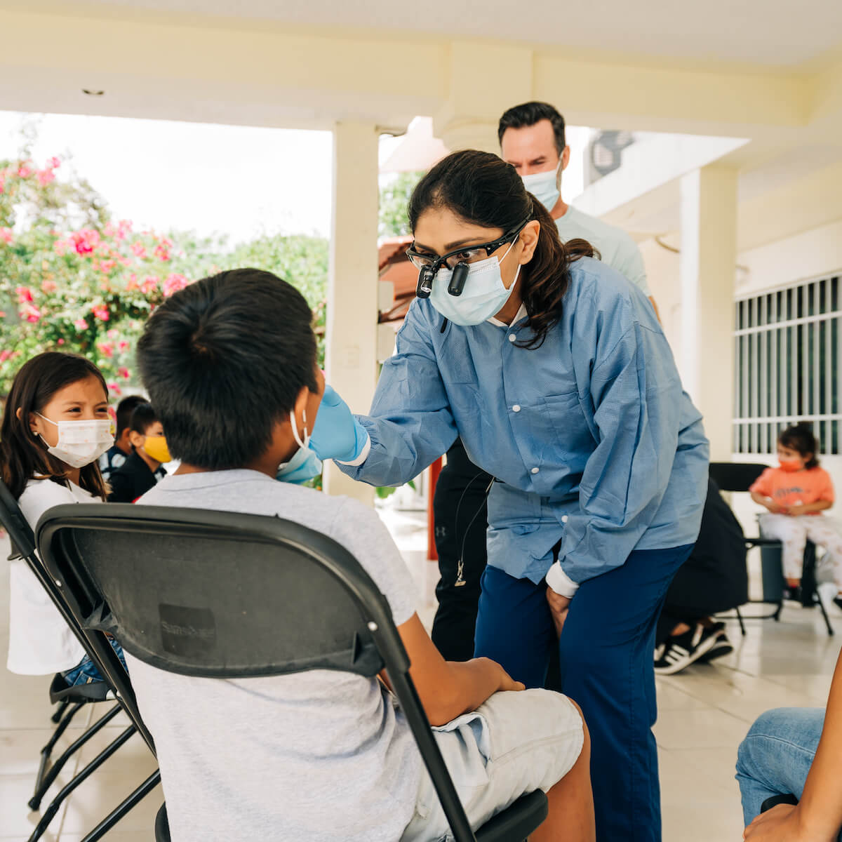 A dentist performs a checkup on a pediatric patient on a humanitarian aid trip to Mexico.